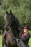 Frau streichelt Friese / woman is fondling friesian horse